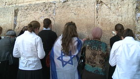 Woman at the western wall stock video footage