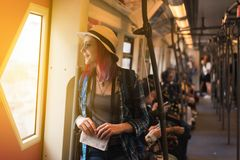 Woman westerner write admire view from train`s window. In morning royalty free stock photo