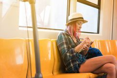 Woman westerner write diary during travel via public train trans. Portation royalty free stock images