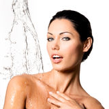 Woman with wet body and splashes of water Stock Photos