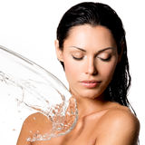 Woman with wet body and splashes of water Stock Image