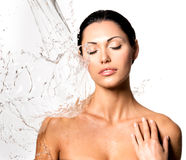 Woman with wet body and splashes of water. Beautiful naked woman with wet body and splashes of water Stock Photo