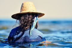Woman in wet dress. Woman with hat and wet dress in water Royalty Free Stock Images