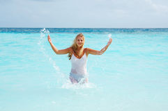 Woman in wet gauzy dress Royalty Free Stock Image