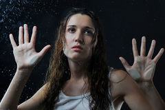Woman with wet hair behind glass Stock Photos