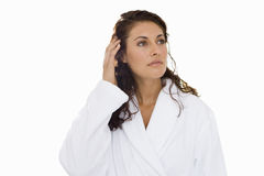 Woman with wet hair in robe with hand on hair, cut out Royalty Free Stock Image