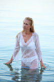 Woman in wet shirt Stock Photography