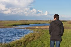 Woman in a wetland landscape in the Netherlands Royalty Free Stock Images