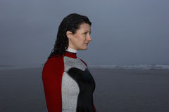 Woman In Wetsuit Looking Away At Beach Royalty Free Stock Photos