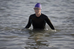 Woman in wetsuit in water Stock Image