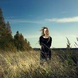 Woman in wheat field. Photo of beautiful elegant woman in wheat field Royalty Free Stock Image