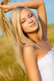 Woman on wheat field royalty free stock images