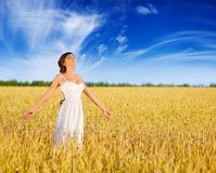 Woman on wheat field Stock Image