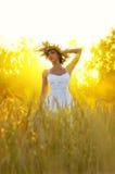Woman on wheat field Royalty Free Stock Photo
