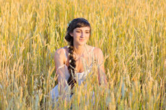 Woman on wheat field Stock Photos