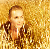 Woman on wheat field Royalty Free Stock Image