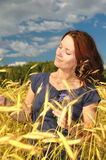 Woman in a wheat field. Stock Photo