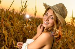 Woman in a wheat field Stock Images