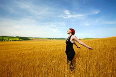 Woman in wheat field enjoying Stock Photos