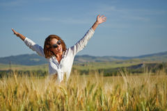 Woman in wheat field enjoying, Royalty Free Stock Photography