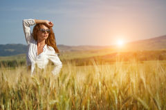 Woman in wheat field enjoying, Royalty Free Stock Images