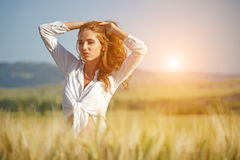 Woman in wheat field enjoying, Royalty Free Stock Photo