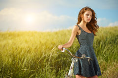 Woman in wheat field enjoying, Stock Photography