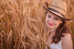 Woman in the wheat field Royalty Free Stock Image