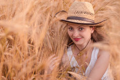 Woman in the wheat field Royalty Free Stock Photo