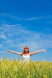 Woman at wheat field in summer day Stock Image