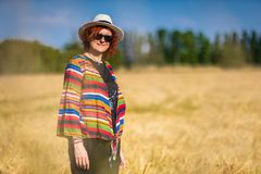 Woman in a wheat field royalty free stock image