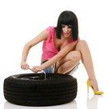 Woman and wheel Stock Images