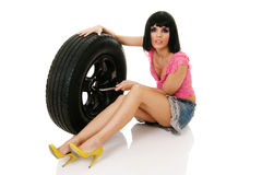 Woman and wheel Stock Photography