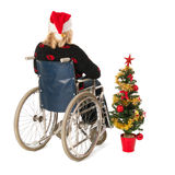 Woman in wheel chair with Christmas tree Royalty Free Stock Photography