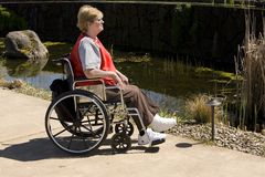 Woman in wheel chair at park royalty free stock photos
