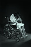 Woman in a wheelchair. An image of a depressed woman in a wheelchair Royalty Free Stock Photos