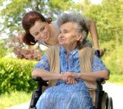 Woman in a wheelchair Stock Photos