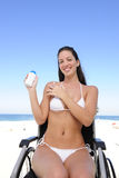 Woman in wheelchair applying sunscreen Royalty Free Stock Photography