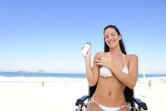 Woman in wheelchair applying sunscreen Stock Photography