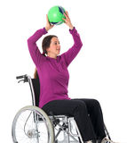 Woman in wheelchair with ball Royalty Free Stock Photography