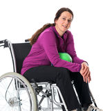 Woman in wheelchair with ball Royalty Free Stock Image