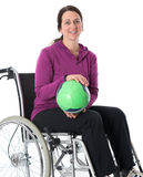 Woman in wheelchair with ball Stock Image