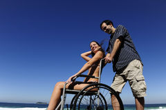 Woman in wheelchair with boyfriend Royalty Free Stock Images
