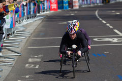 Woman wheelchair competitors on the Virgin London Marathon 2013 Royalty Free Stock Photo