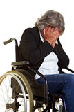 Woman in wheelchair crying. Elderly woman sitting in a wheelchair and crying Royalty Free Stock Photos