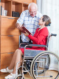 Woman in   wheelchair and   elderly man Royalty Free Stock Photography