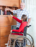 Woman in   wheelchair and   elderly man Stock Photography