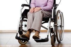Woman on wheelchair Stock Photo