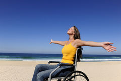 Woman in wheelchair enjoying beach Royalty Free Stock Photos