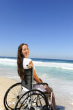 Woman in wheelchair enjoying outdoors beach Royalty Free Stock Image